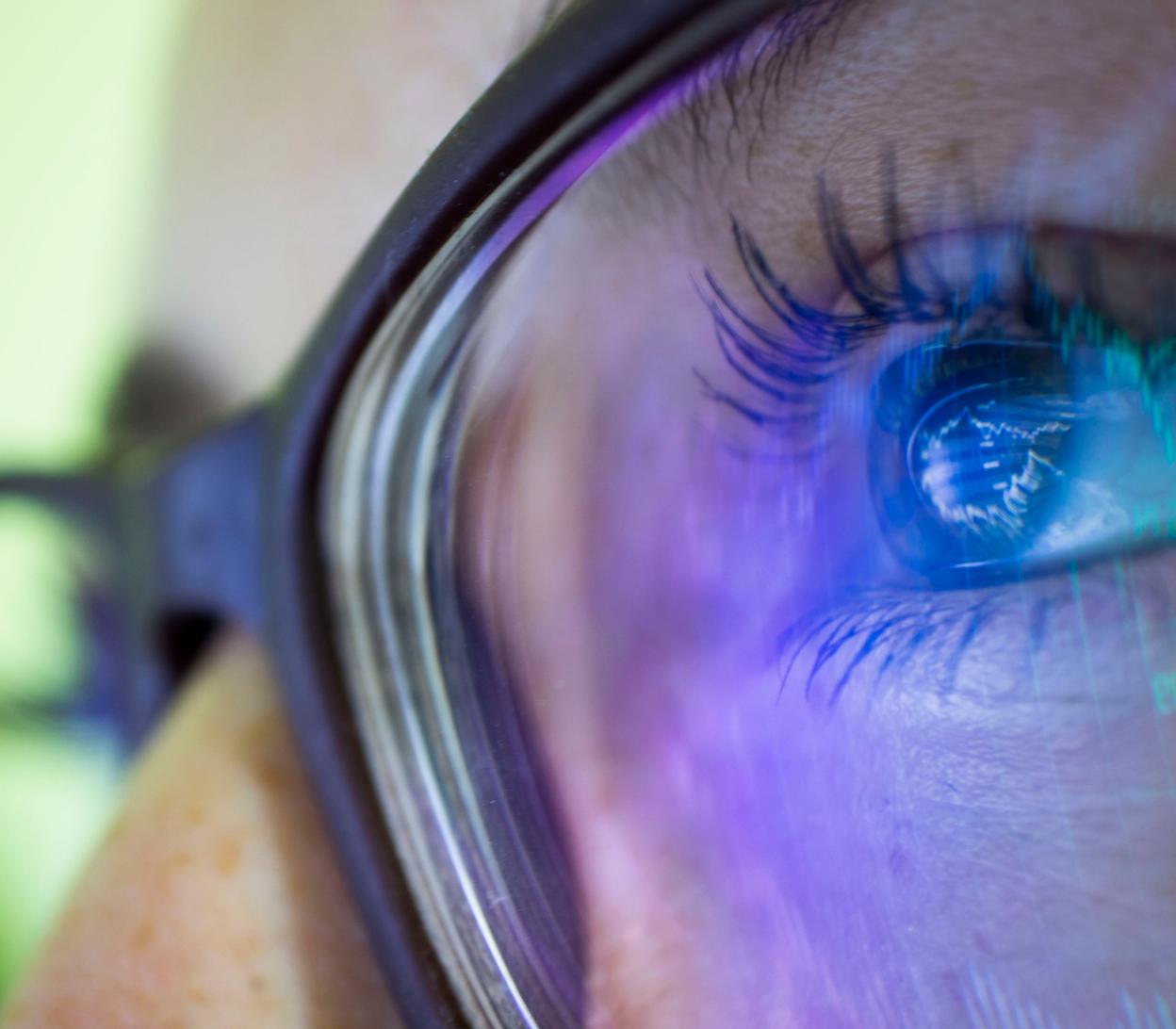 woman wearing blue light glasses