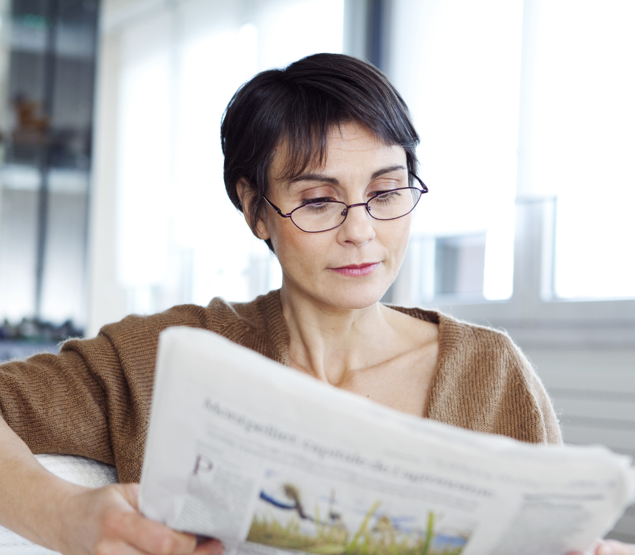 woman reading with her glasses on