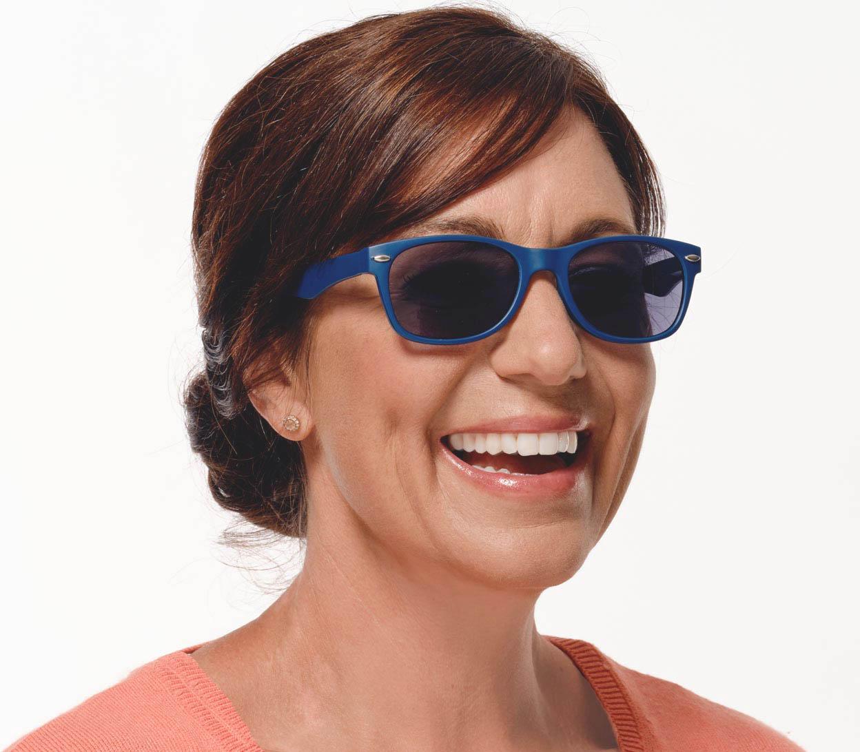 Woman wearing reading sunglasses